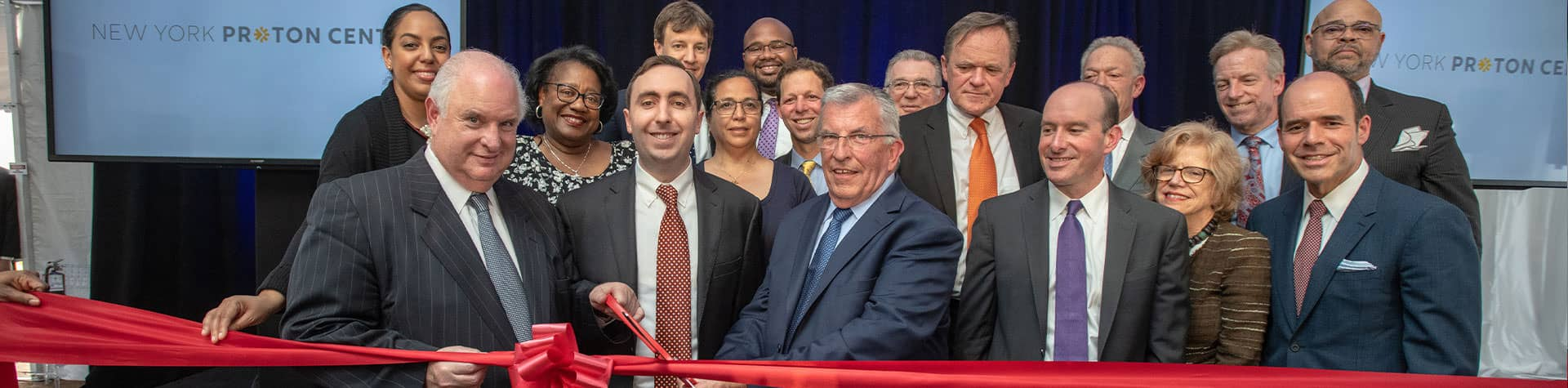 NY Proton Center team cutting ribbon