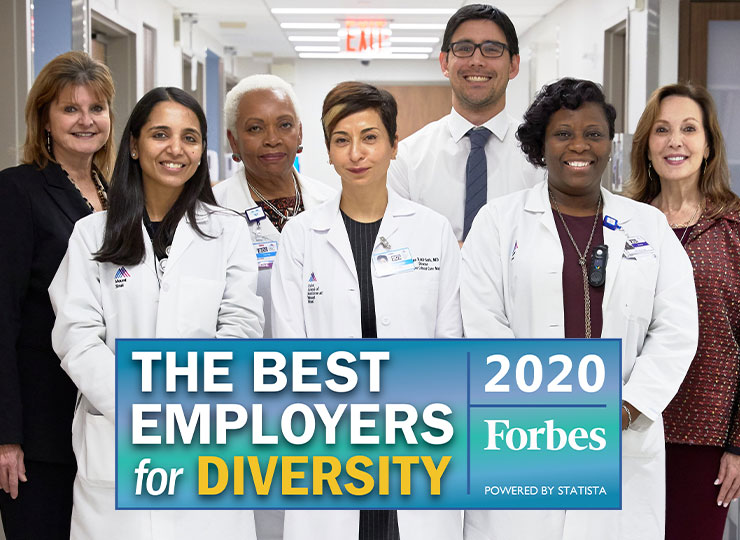 Photo of Diversity team with badge