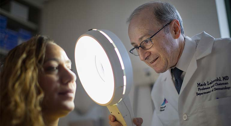 Image of Dr. Mark Lebwohl and patient
