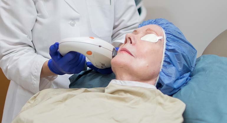 Image of Doctor performing laser procedure on patient