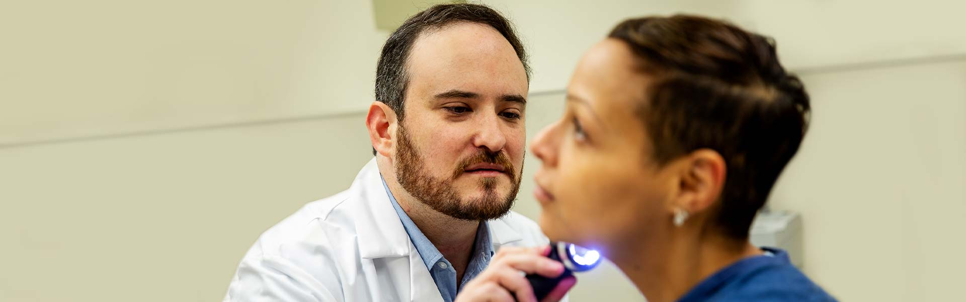 Image of doctor examining patient