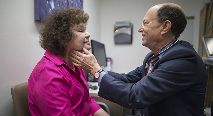 Dr. Richard Haber examines a patient