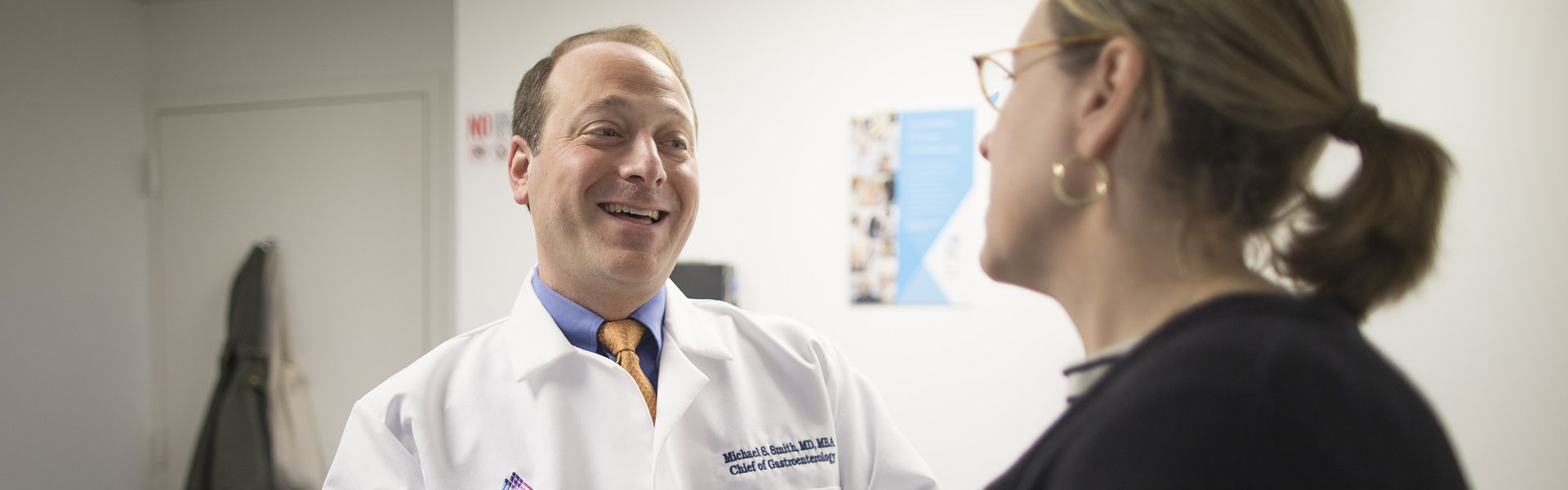Dr. Michael Smith talks to a patient with motility issues