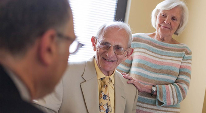 Image of doctor discussing with 2 elderly patients