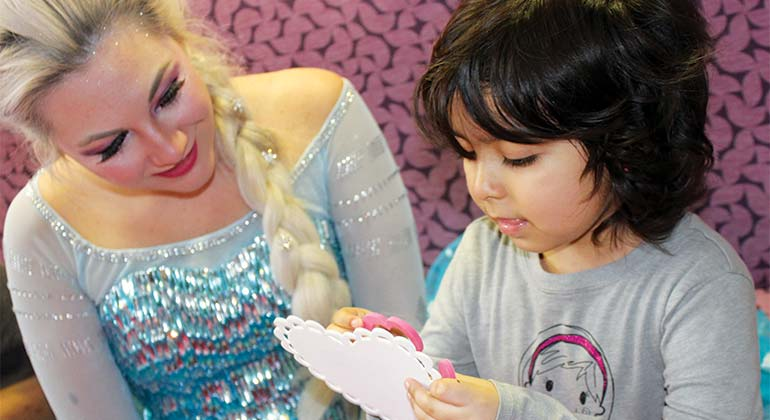 Young girl crafts a valentine with Princess Elsa