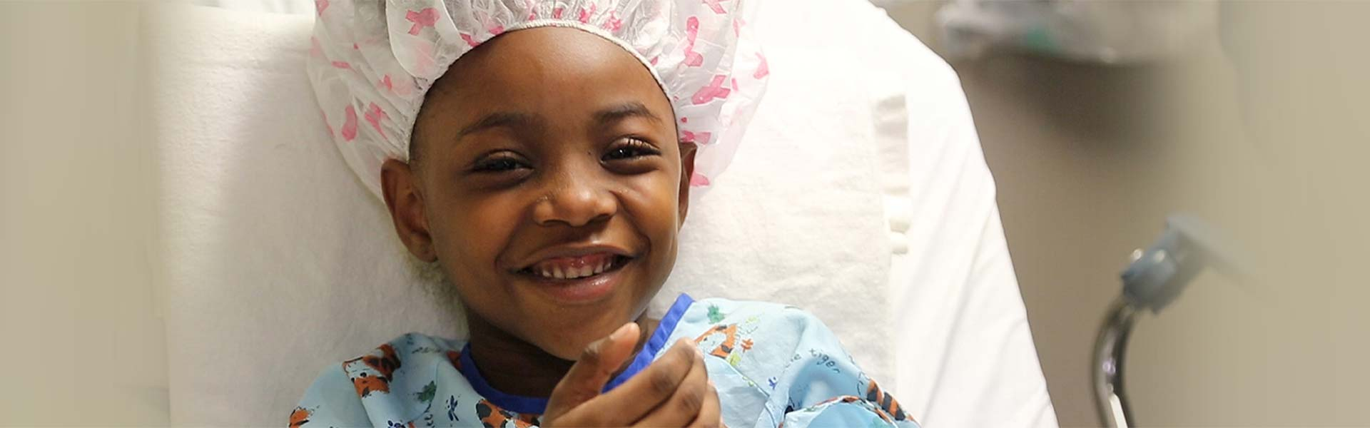 Little boy in surgical garb smiling