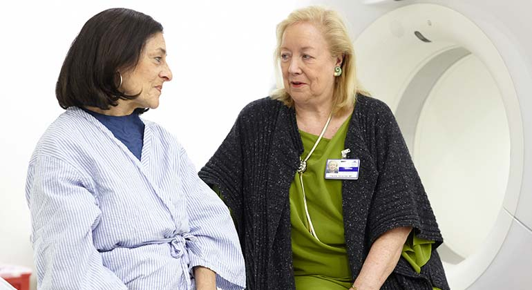 Female doctor siting with a female patient before an imaging procedure