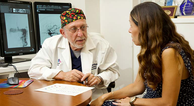 Image of doctor talking to female patient