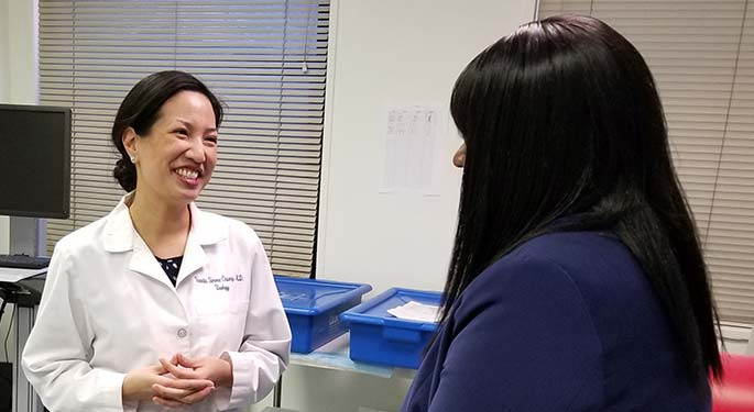 Dr. Simma-Chiang talking to a patient