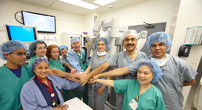 Operating room shot with everyone's hands in the middle