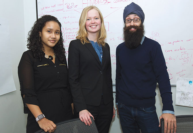 A photo of Prabhjot Singh, MD, PhD, with Hilda Mejias, a Health Coach in Harlem; and Anna Stapleton, Program Manager for Policy at The Arnhold Institute for Global Health.