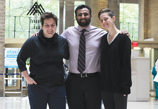 A photo of LGBTQ+PiM co-leaders Les James, Murad Khan, and Elizabeth Tarras
