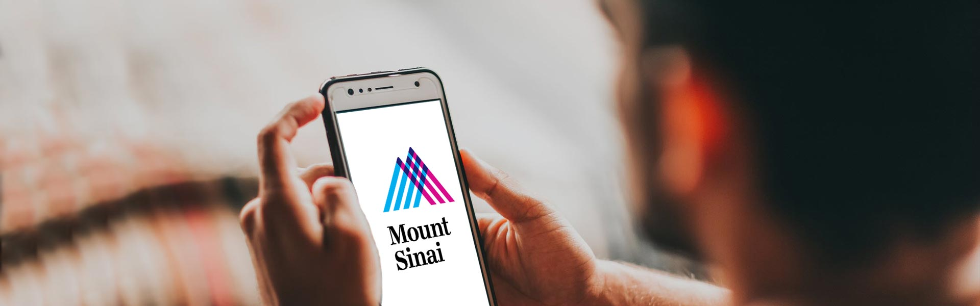 iPhone with a Mount Sinai logo