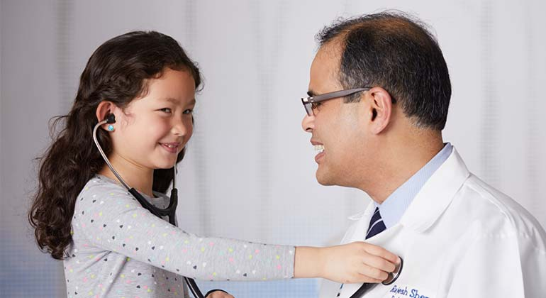 image of doctor and little girl