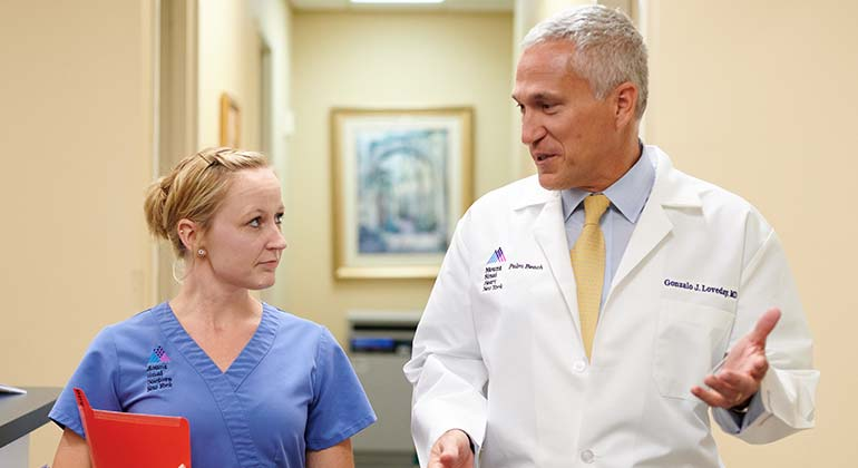 Image of doctor and nurse talking