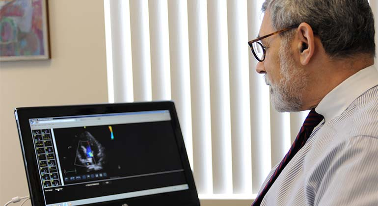 Doctor analyzing results on screen
