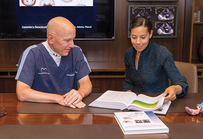 A photo of David H. Adams, MD, and Joanna Chikwe, MD
