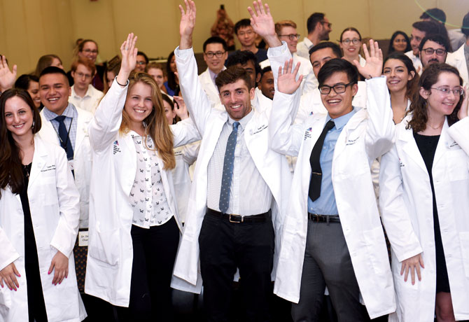 Photo shows participants at the inaugural PhD Lab Coat Ceremony