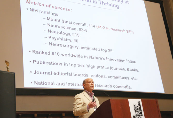 A photo shows Eric J. Nestler, MD, PhD, at the lectern