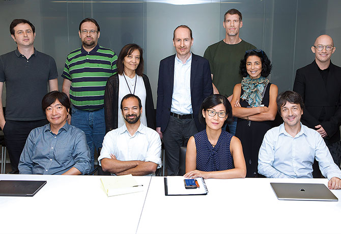 A photo showing Sacha Gnjatic, PhD, and Miriam Merad, MD, PhD, with team of Mount Sinai researchers