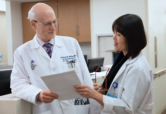 A photo of Edward M. Wolin, MD, and Siok (Ann) Khor, NP
