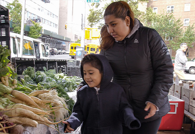 A photo showing Natalia Leal and her son Gabriel, who were participants in the FAMILIA trial.