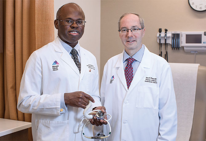 A photo shows Anelechi Anyanwu, MD, Professor and Vice Chair of Cardiovascular Surgery, and Surgical Director, Heart Transplantation and Mechanical Circulatory Support, Mount Sinai Health System, and Sean P. Pinney, MD, with the HeartMate 3 device.