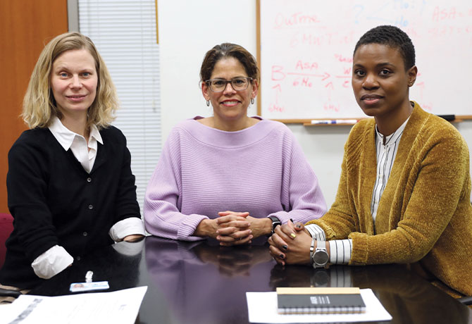 A photo of Elizabeth A. Howell, MD, MPP, with Teresa Janevic, PhD, MPH, and Tracy Layne, PhD, both Assistant Professors of Population Health and Policy, and Obstetrics, Gynecology and Reproductive Science.