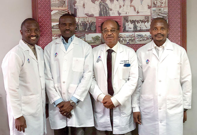 A photo at the John F. Kennedy Medical Center in Monrovia, Liberia, shows physicians Ehigha Enabudoso, MD, Edwin Olokor, MD, Etedafe Gharoro, MD, and Ayyuba Rabiu, MD, are among staff members funded by the World Bank Workforce grant.