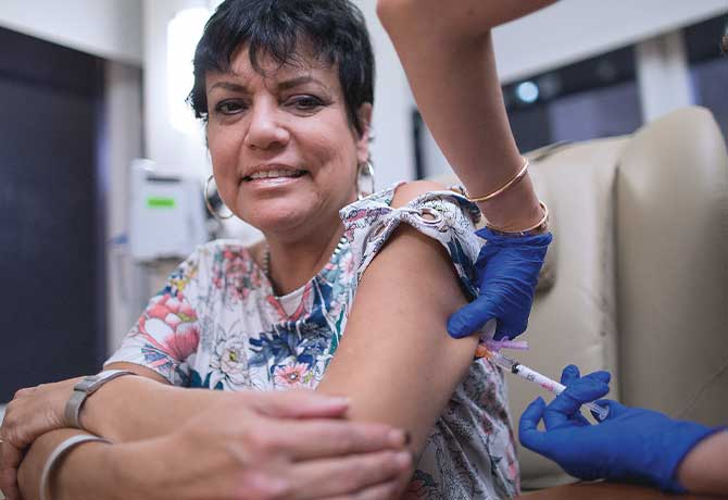 A photo shows patient Evelyn Ramos Santiago receiving an injection of mepolizumab at the Mount Sinai Therapeutic Infusion Center.