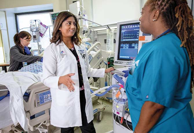 A photo shows Kusum Mathews, MD, with respiratory therapist Julia Nuzzo and Onyl Codner, RN