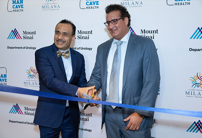 A photo of Thomas Milana, Jr. celebrating the Man Cave Health opening with Ash Tewari, MBBS, MCh.