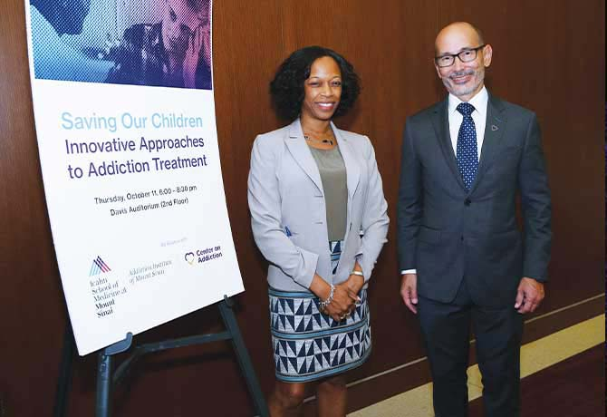 A photo showing Yasmin Hurd, PhD, with Charles J. Neighbors, PhD, MBA, Director of Health Services Research, Center on Addiction.