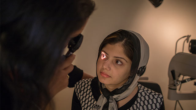 image of eye doctor with patient