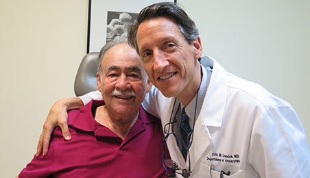 Dr. Carlos Rios and patient