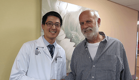 Dr. Fred Lin with patient