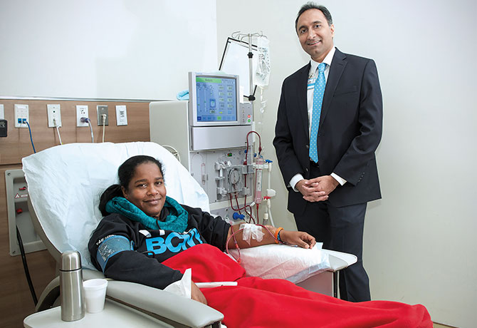 A photo showing Vijay Lapsia, MD and patient Roxanne Holder