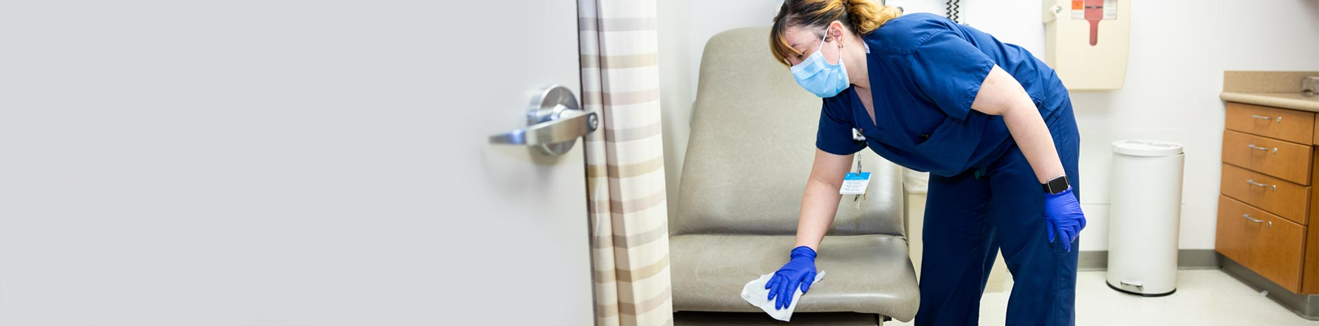 Image of nurse cleaning
