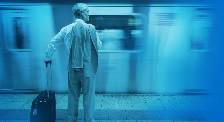 Image of man waiting for subway train