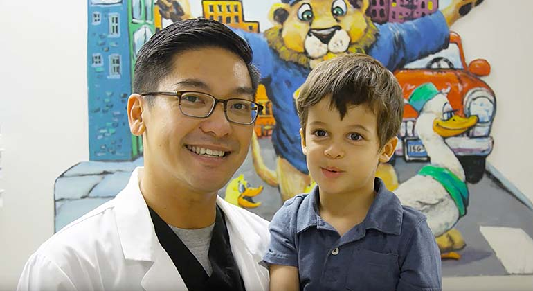 Image of doctor holding small boy