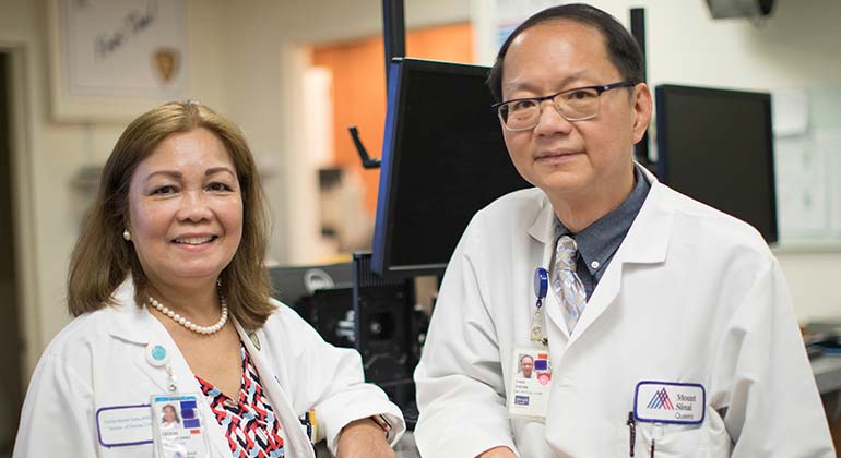 Male and female doctor from Mount Sinai Queens in a work area