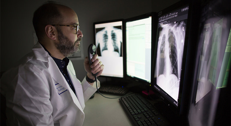 Radiologist looking at images on screen