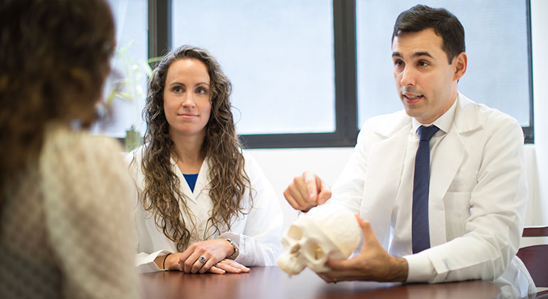 Doctors with model of skull