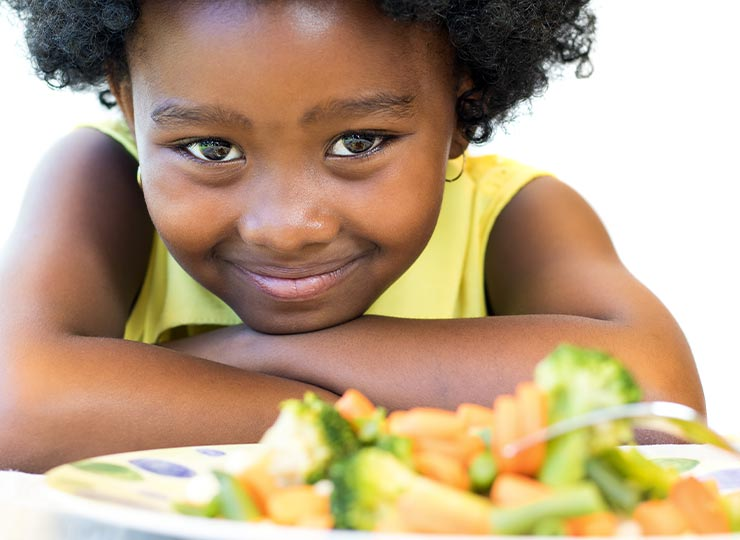 Photo of Young child with healthy food
