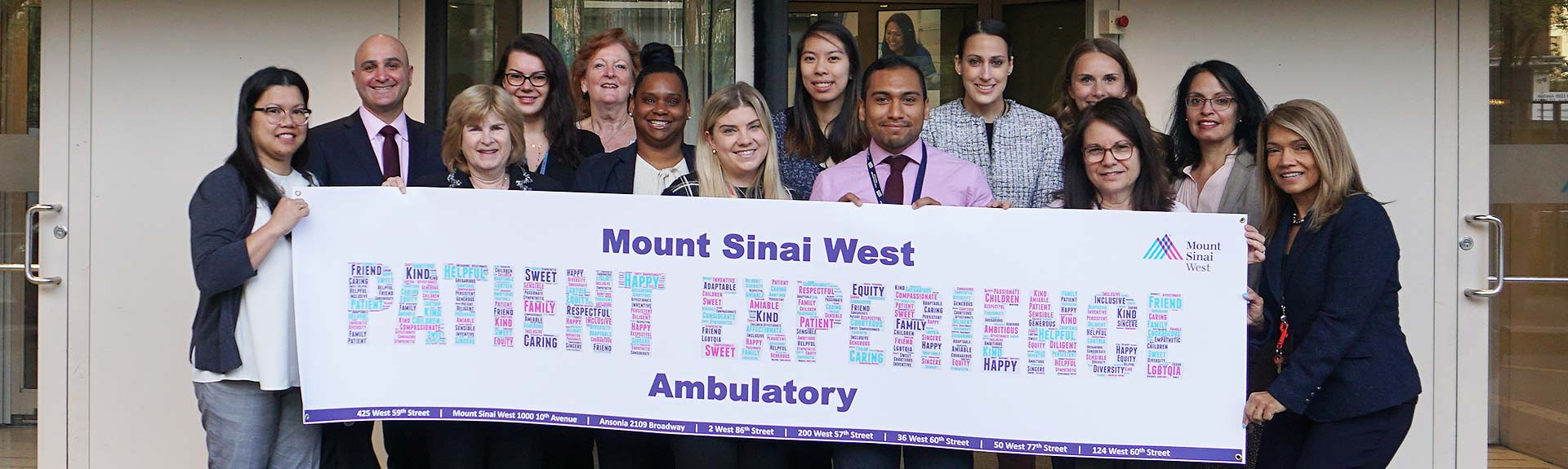 "Group holding sign that reads ""Mount Sinai West Patient Experience Ambulatory"""