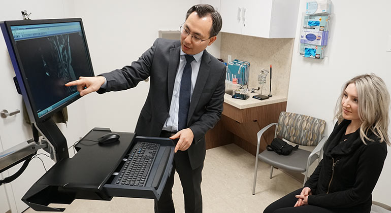 image of doctor showing scans to patient