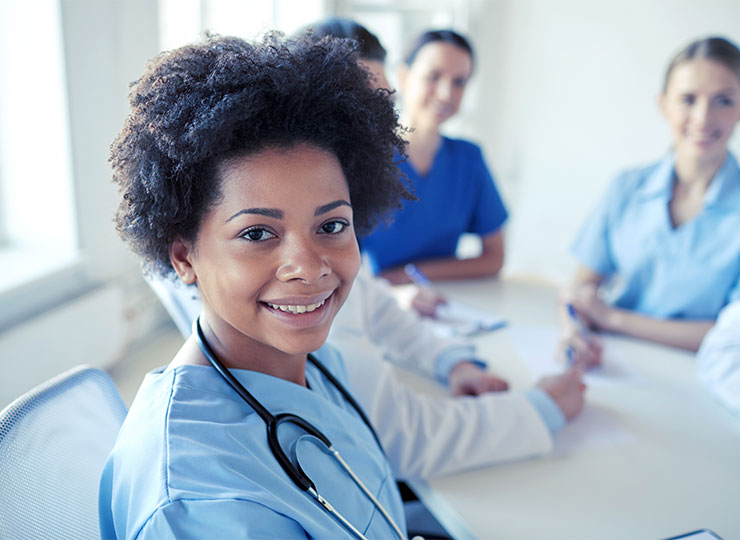 Nurse smiling with group.