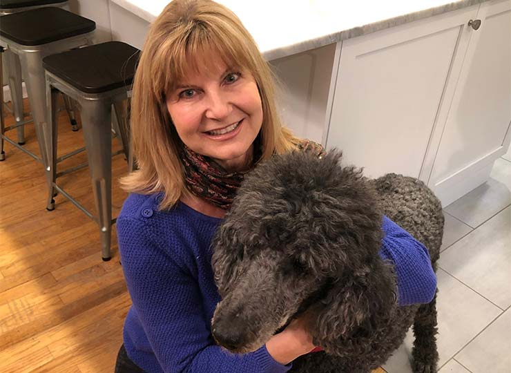 Photo of Lorraine Dibble holding her dog