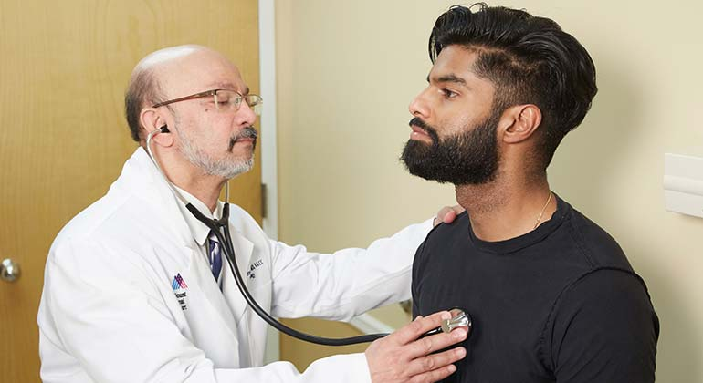 Patient and doctor with stethoscope