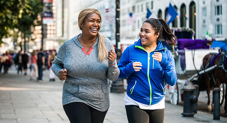 image of 2 healthy women jogging